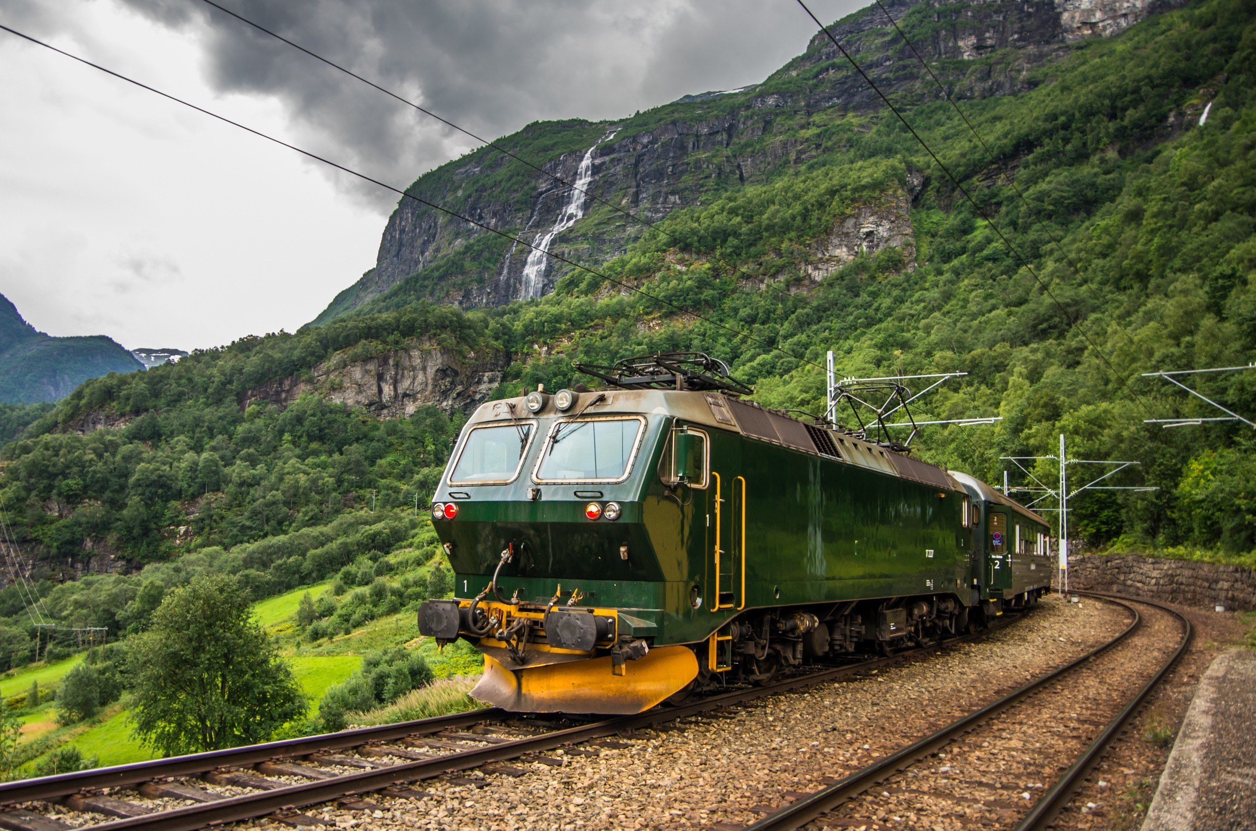 Train at famous Flam railway Flåmsbana line in Flam valley in Norway