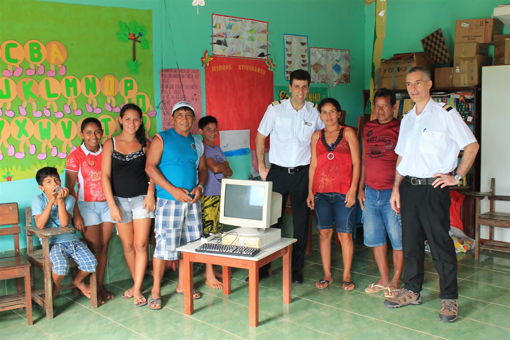 CMV donate computer to village
