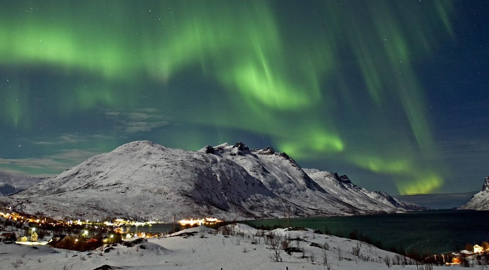 Northern Lights over the Ersfjord in Tromso