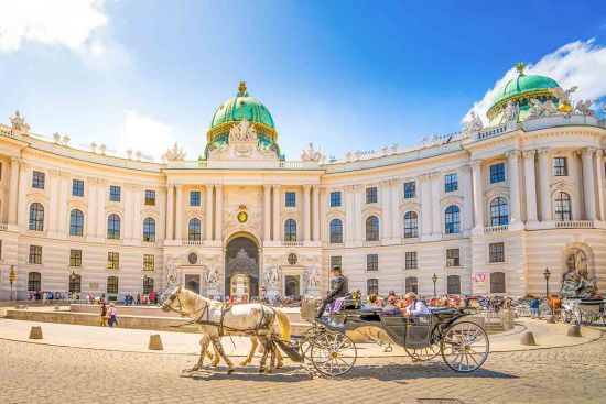 Horse and carriage outside Alte Hofburg, Vienna, Austria
