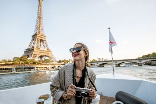 Lady sightseeing on a boat in Paris