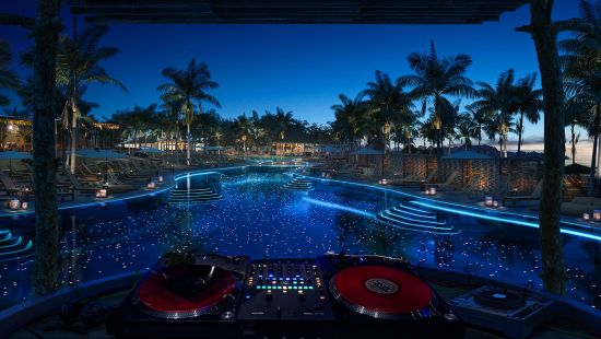 Virgin Voyages Beach Club at Bimini at night, where Mark Ronson will perform