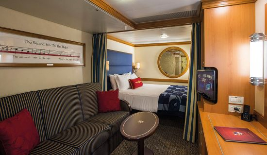 Disney Magic & Disney Wonder Inside Cabin featuring bed, sofa and side table