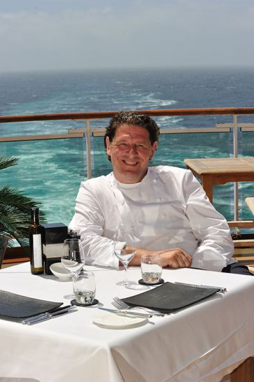 Marco Pierre White sitting out on deck on board P&0 Cruises ship as one of their Food Heroes
