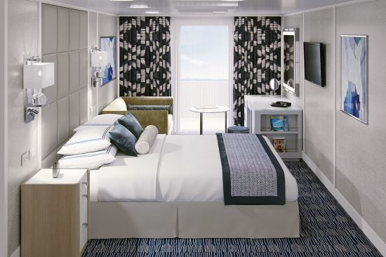 Oceania Cruises Concierge Veranda stateroom with bed and blue furnishings