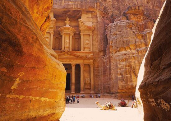 The cliff face and temple at Petra with camels