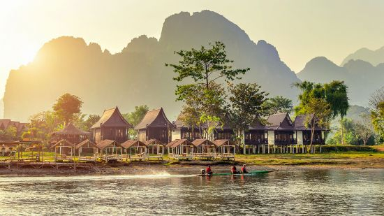 Village and bungalows along Nam Song River in Vang Vieng, Laos