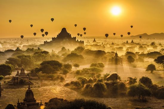 Dawn balloon flight over Myanmar Asia river