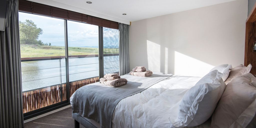 Cabin aboard the African Dream looks out onto Lake Kariba
