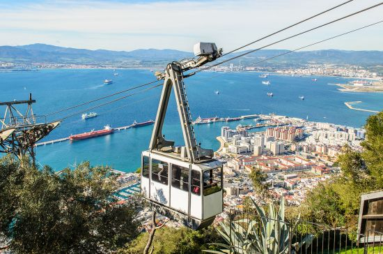 Cable car above Gibraltar rock on way to Alameda gardens in Gibraltar