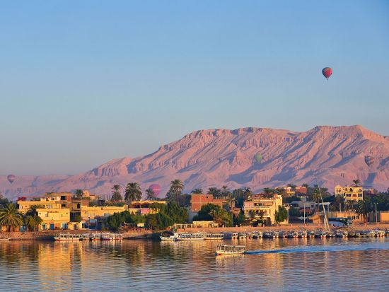 River cruise on the Nile with a hot air balloon in background
