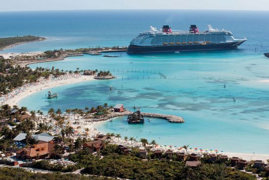 Disney cruise line's ship docked by Castaway Cay private island