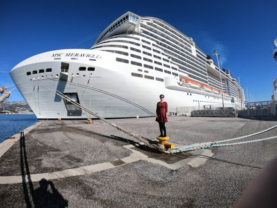 Emma Le Teace in front of MSC Cruises ship