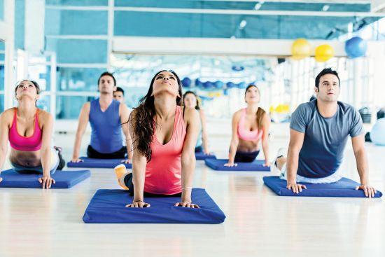 People enjoying yoga class