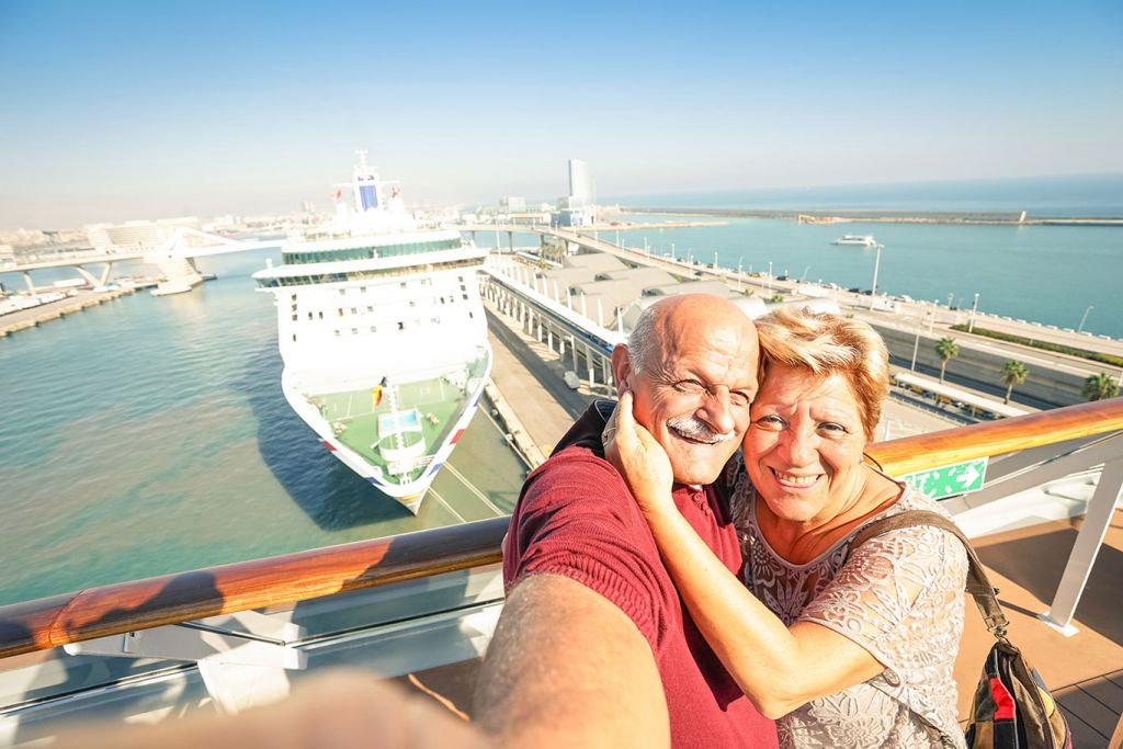 Older couple take photo on cruise holiday