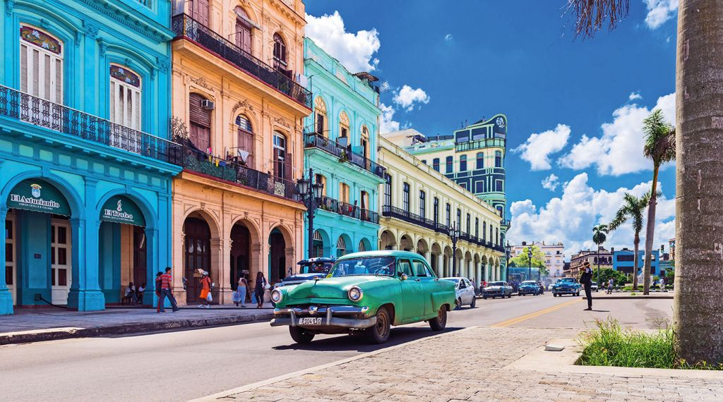 Colourful houses and classic car in Cuba