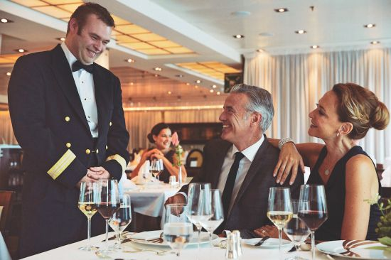 luxury cruises officer with guests